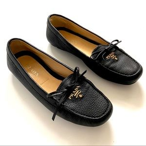 Authentic Prada pebbled leather black loafers bow